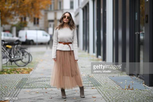 Anna Schürrle wearing Gianvito Rossi heels Dorothee Schumacher skirt Joseph sweater and Isabel Marant belt on November 16 2019 in Berlin Germany