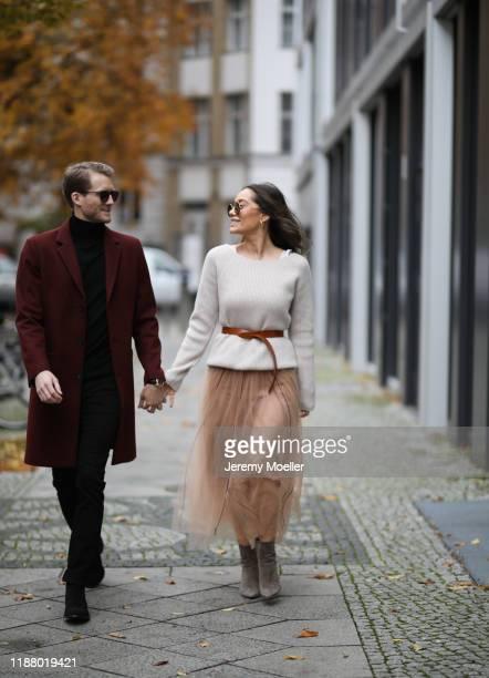 Anna Schürrle wearing Gianvito Rossi heels, Dorothee Schumacher skirt, Joseph sweater and Isabel Marant belt and Andre Schürrle wearing Saint Laurent...