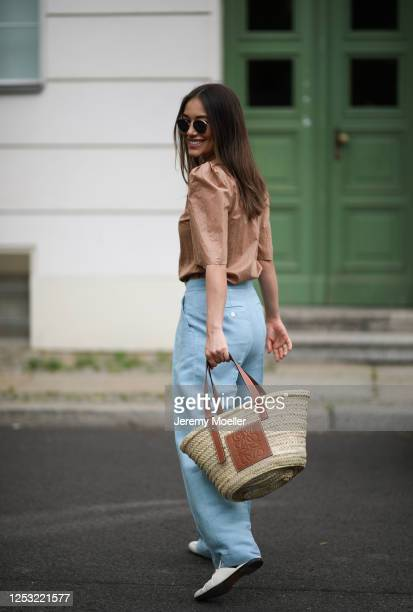 Anna Schürrle wearing Gucci loafer Bottega Veneta shades Gestuz blouse Max Mara pants and Loewe bag on June 28 2020 in Berlin Germany