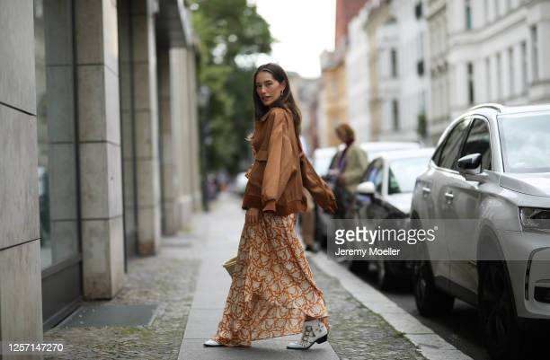 Anna Schürrle wearing Hannah dress Chloe boots and Barena jacket on July 17 2020 in Berlin Germany