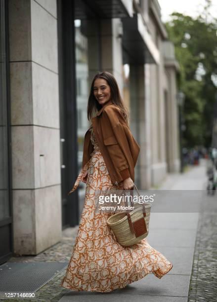 Anna Schürrle wearing Hannah dress, Chloe boots, Barena jacket and Loewe bag on July 17, 2020 in Berlin, Germany.
