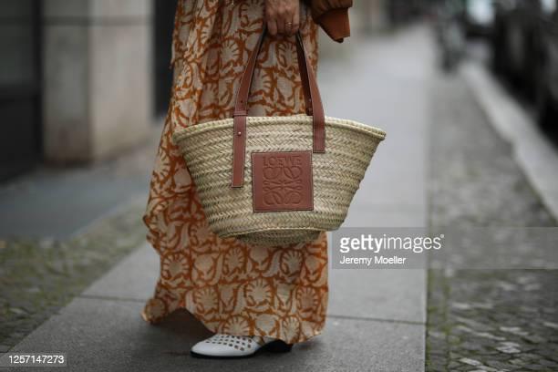Anna Schürrle wearing Hannah dress Chloe boots Barena jacket and Loewe bag on July 17 2020 in Berlin Germany