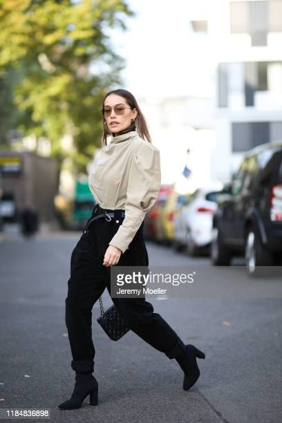 Anna Schürrle wearing Isabel Marant pants belt and shirt Chanel bag Gianvito Rossi heels Jane Koenig earring on October 31 2019 in Berlin Germany
