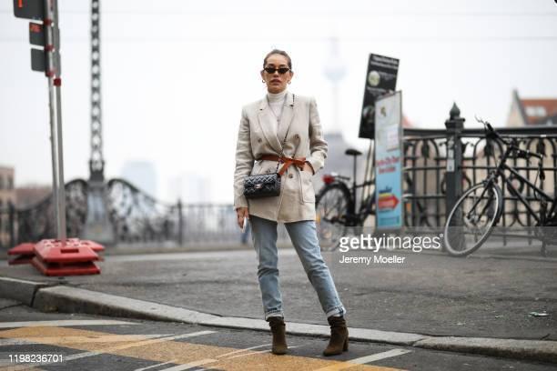 Anna Schürrle wearing Michael Kors blazer, Chanel bag, Agolde jeans, Aquazurra boots, Isabel Marant belt, Missoma London earrings and Intimissimi top...