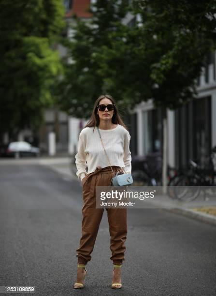 Anna Schürrle wearing Munthe pants, Twenty Montreal top, Chloe bag and Gianvito Rossi heels on June 28, 2020 in Berlin, Germany.