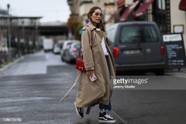 Anna Schürrle wearing red leather Hermes bag, Djerf Avenue sweater, JBrand jeans, Hugo Boss coat and Vans sneaker on November 19, 2020 in Berlin,...