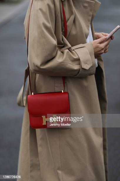 Anna Schürrle wearing red leather Hermes bag, Hugo Boss coat on November 19, 2020 in Berlin, Germany.