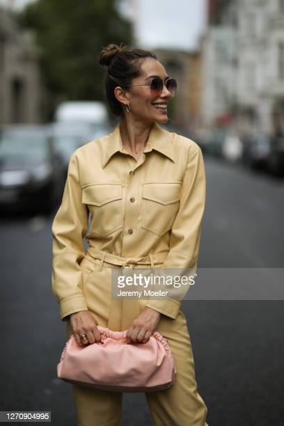 Anna Schürrle wearing rosa Mansur Gavriel bag, yellow Nanushka jumpsuits and Barton Perreira shades on September 04, 2020 in Berlin, Germany.