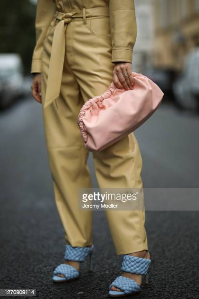 Anna Schürrle wearing rosa Mansur Gavriel bag, yellow Nanushka jumpsuits, Bottega Veneta blue heels on September 04, 2020 in Berlin, Germany.