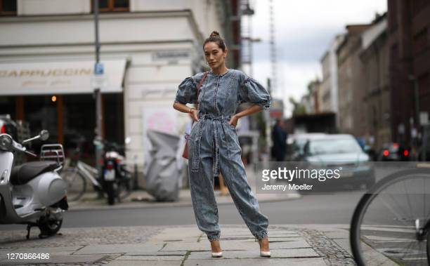 Anna Schürrle wearing Ulla Johnson blue jeans jumpsuits, Rosa Mansur Gavriel bag and beige Gianvito Rossi heels on September 04, 2020 in Berlin,...