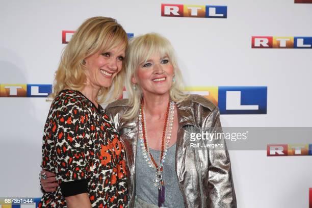 Anna Schudt and Gaby Koester attend the premiere of the film 'Gaby Koester Ein Schnupfen haette auch gereicht' at Residenz Kino on April 11 2017 in...