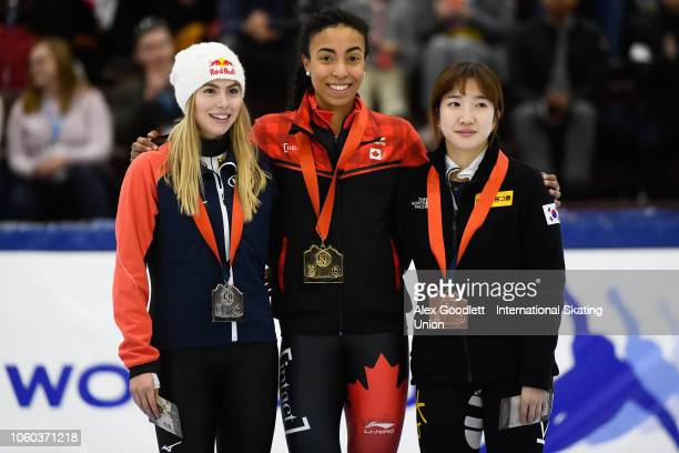 Anna Seidel of Germany Alyson Charles of Canada and Ah Rum Noh of Korea pose for a picture after the ladies 1000m final during ISU World Cup Short...