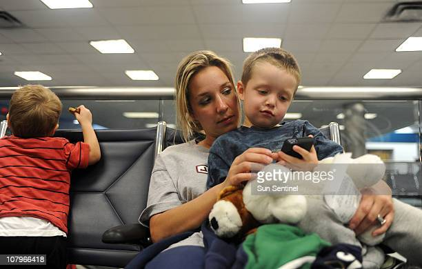 Anna Shalan of Pittsburgh Pennsylvania entertains her son Ricky Furgiuele after her plane to Pittsburgh was cancelled at Fort LauderdaleHollywood...