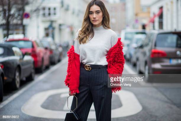 Anna Sharypova wearing Gucci belt grey HM turtleneck red jacket other stories navy striped HM pants Zara bag Buffalo heels on December 16 2017 in...