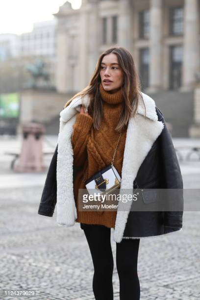 Anna Sharypova wearing Maison Margiela jacket and Prada bag on January 23 2019 in Berlin Germany