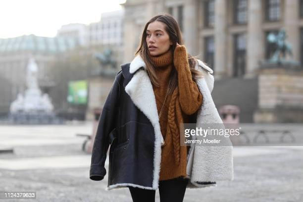 Anna Sharypova wearing Maison Margiela jacket and Prada bag on January 23, 2019 in Berlin, Germany.