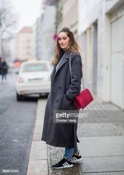 Anna Sharypova wearing red Agneel bag dark grey COS wool coat Adidas sneaker boyfriend denim jeans other stories top Uniqlo on December 16 2017 in...