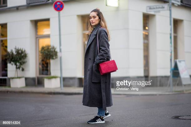 Anna Sharypova wearing red Agneel bag dark grey COS wool coat Adidas sneaker boyfriend denim jeans other stories top Uniqlo on December 16 2017 in...