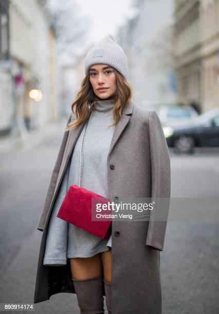 Anna Sharypova wearing Stuart Weitzman overknee boots, a grey COS coat, red Agneel bag, grey COS turtleneck on December 16, 2017 in Berlin, Germany.