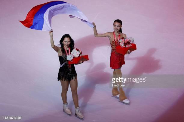 Anna Shcherbakova and Elizaveta Tuktamysheva of Russia skates with the Russia national flagafter awarding ceremony the Ladies Free Skating during the...