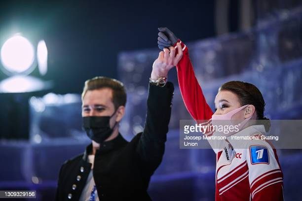 Anna Shcherbakova of FSR reacts to her winning result with her coach Daniil Gleikhengauz at the kiss and cry in the Ladies Free Skating during day...
