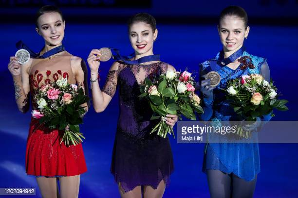 Anna Shcherbakova of Russia Alena Kostornaia of Russia and Alexandra Trusova of Russia pose in the Ladies medal ceremony during day 4 of the ISU...