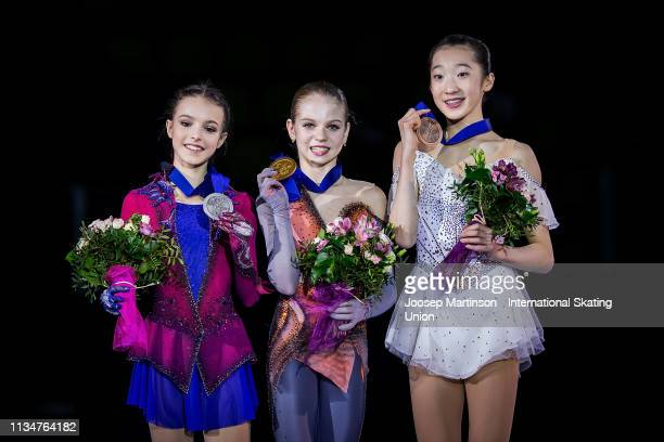 Anna Shcherbakova of Russia Alexandra Trusova of Russia and Ting Cui of the United States pose in the Junior Ladies medal ceremony during day 4 of...