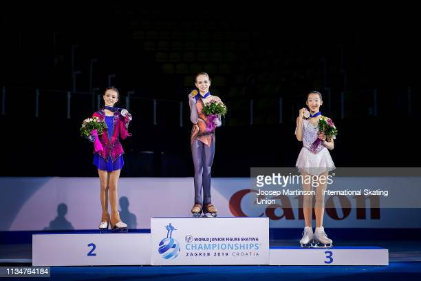 Anna Shcherbakova of Russia , Alexandra Trusova of Russia and Ting Cui of the United States pose in the Junior Ladies medal ceremony during day 4 of...