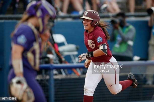 Anna Shelnutt of the Florida State Seminoles celebrates her home run against the Washington Huskies during the Division I Women's Softball...