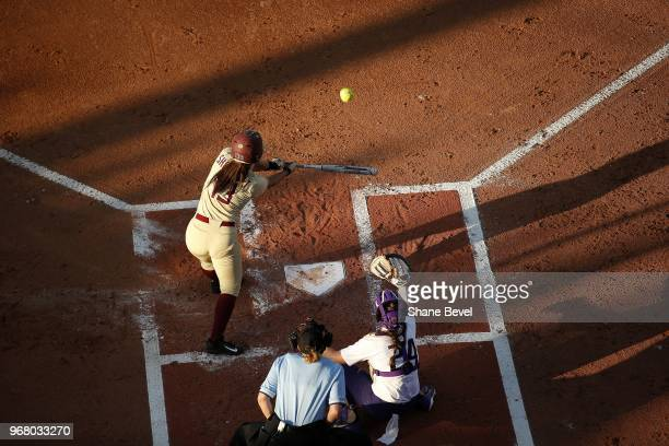 Anna Shelnutt of the Florida State Seminoles hits a home run against the Washington Huskies during the Division I Women's Softball Championship held...