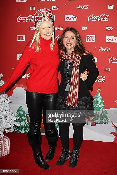Anna Sherbinina and actress Victoria Abril attend the 'Association Petits Princes' And Coca Cola Red Train Launch at Gare de L'Est on December 15...
