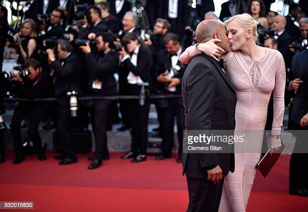 Anna Sherbinina kisses a guest prior the screening of Julieta at the annual 69th Cannes Film Festival at Palais des Festivals on May 17 2016 in...