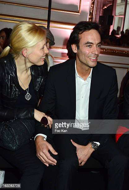 Anna Sherbininaand Anthony Delon attend the Jitrois Front Row PFW F/W 2013 at Hotel Saint James Albany on March 6 2013 in Paris France