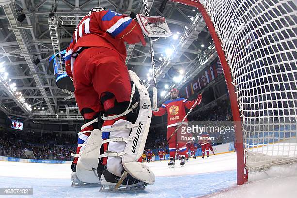 Anna Shukina of Russia celebrates with teammate Yulia Leskina after defeating the Germany 4 to 1 in their Women's Ice Hockey Preliminary Round Group...