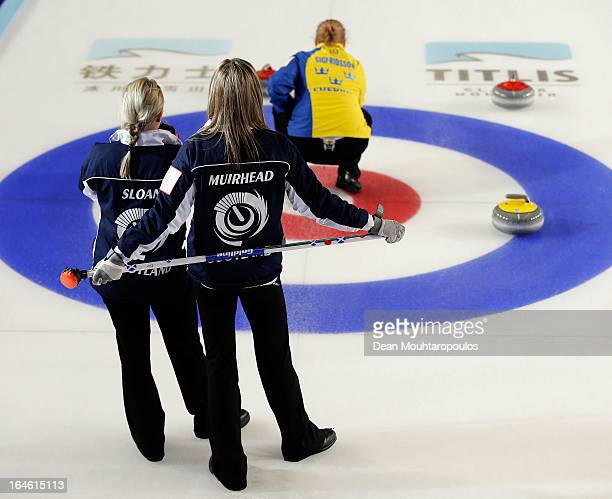 Anna Sloan and Eve Muirhead of Scotland and Margaretha Sigfridsson of Sweden look on in the Gold medal match between Sweden and Scotland on Day 9 of...