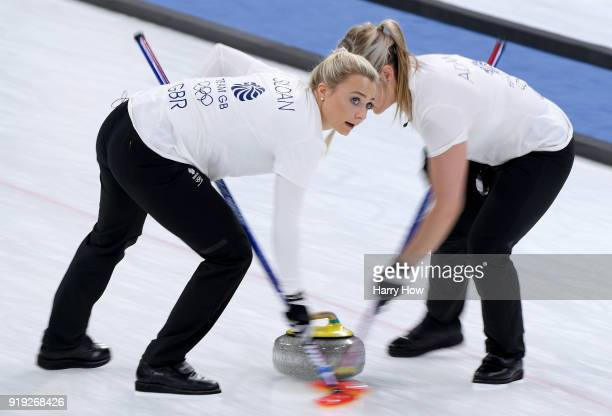 Anna Sloan and Vicki Adams of Great Britain sweep in a match against South Korea during the Women's Curling Round Robin on day eight of the...