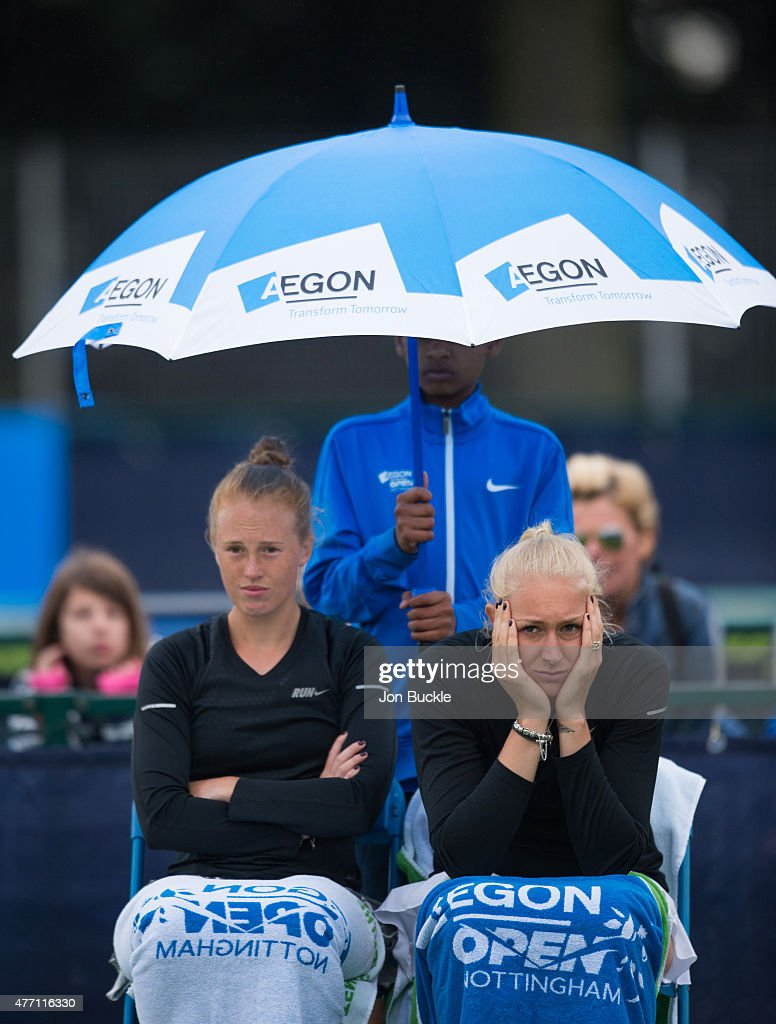 Anna Smith and Jocelyn Rae of Great Britain wait for the rain to stop during their doubles match against Yung-Jan Chan and Jie Zheng of China on day seven of the WTA Aegon Open Nottingham at Nottingham Tennis Centre on June 14, 2015 in Nottingham, England.