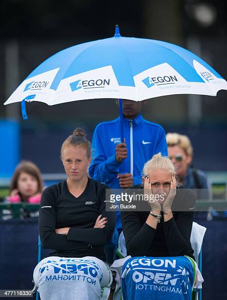 Anna Smith and Jocelyn Rae of Great Britain wait for the rain to stop during their doubles match against YungJan Chan and Jie Zheng of China on day...