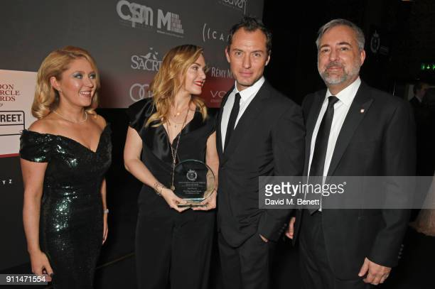 Anna Smith Kate Winslet winner of The Dilys Powell Award for Excellence in Film presenter Jude Law and Rich Cline attend the London Film Critics'...