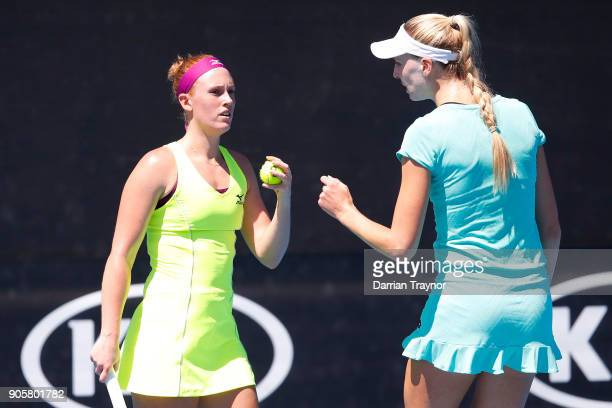Anna Smith of Great Britain and Naomi Broady of Great Britain talk tactics in their first round women's doubles match against Barbora Strycova of the...