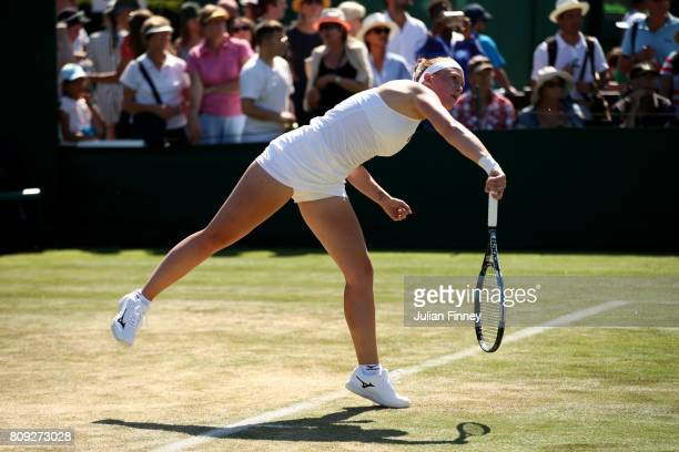 Anna Smith of Great Britain serves Nicole Melichar during the Ladies Doubles first round match against Svetlana Kuznetsova of Russia and Kristina...