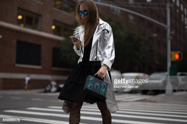 Anna Sokol is seen attending Marchesa during New York Fashion Week wearing a silver jacket with green bug bag on September 13 2017 in New York City
