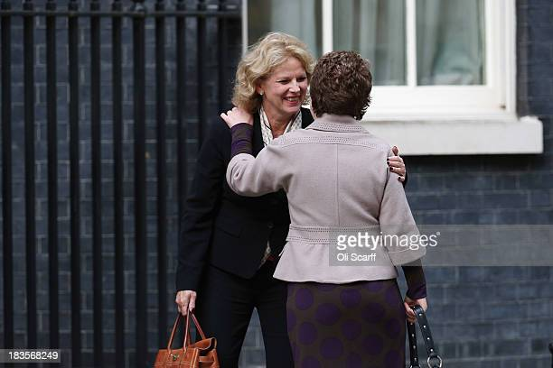 Anna Soubry MP congratulates Baroness Tina Stowell as she arrives at Number 10 Downing Street on October 7 2013 in London England British Prime...