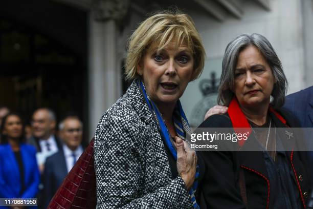Anna Soubry UK lawmaker left and Liz SavilleRoberts UK lawmaker speak to members of the media outside the Supreme Court in London UK on Tuesday Sept...