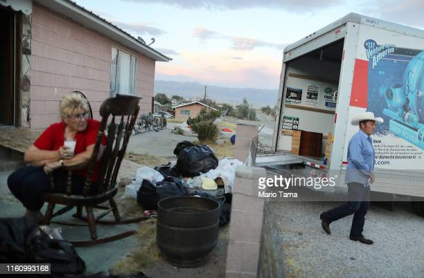 Anna Sue and Benny Eldridge gather outside their home which has been deemed uninhabitable due to structural damage from the recent 71 magnitude...