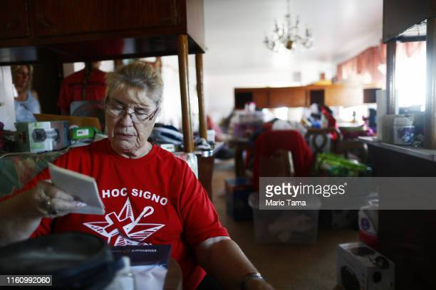 Anna Sue Eldridge sorts through items while packing in her home which has been deemed uninhabitable due to structural damage from the recent 71...