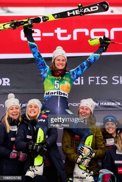 MARIBOR SLOVENIA MARIBOR SLOVENIA Anna Swenn Larsson of Sweden and her team on the podium celebrating her second place at the Audi FIS Alpine Ski...