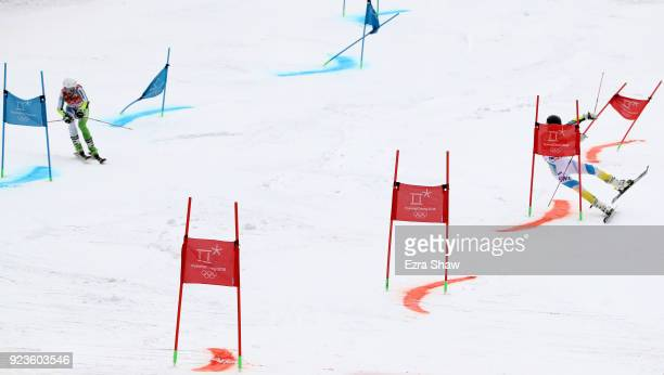 Anna Swenn Larsson of Sweden crashes with Tina Robnik of Slovenia during the Alpine Team Event 1/8 Finals on day 15 of the PyeongChang 2018 Winter...