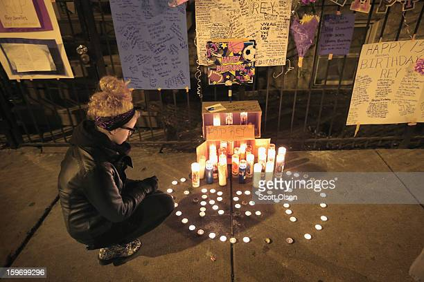 Anna Szydlo looks over a memorial in front of the home of Rey Dorantes on what would have been his 15th birthday on January 15 2013 in Chicago...