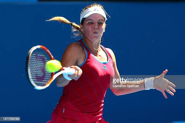 Anna Tatishvili of Georgia plays a forehand in her second round match against Caroline Wozniacki of Denmark during day three of the 2012 Australian...
